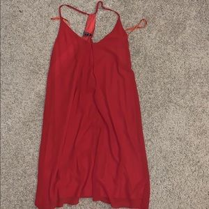 This is a Gianni Bini rust color dress